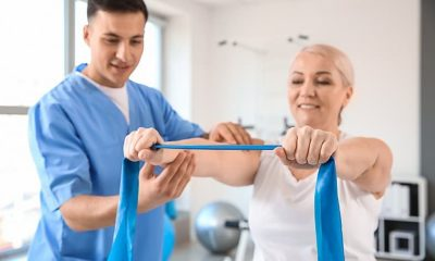https://www.whitehallofdeerfield.com/wp-content/uploads/2020/10/PHOTO-Shutterstock-WH-PHYSICAL-THERAPY-THERAPIST-FEMALE-PATIENT-WITH-BLUE-RIBBON-THING-400x240.jpg