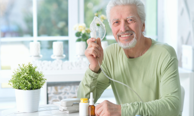 https://www.whitehallofdeerfield.com/wp-content/uploads/2020/11/PHOTO-Shutterstock-WH-RESPIRATORY-THERAPY-MALE-PATIENT-Holding-Oxygen-400x240.png