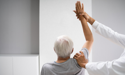 https://www.whitehallofdeerfield.com/wp-content/uploads/2021/01/PHOTO-Shutterstock-WH-2021-PHYSICAL-THERAPY-Older-Woman-from-Behind-with-Therapist-400x240.png