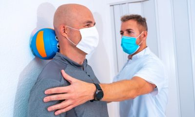 https://www.whitehallofdeerfield.com/wp-content/uploads/2021/04/PHOTO-Shutterstock-WH-2021-RECOVERING-AT-A-SNF-Male-Therapist-with-Older-Male-Patient-in-Masks-400x240.jpg