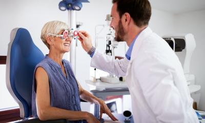 https://www.whitehallofdeerfield.com/wp-content/uploads/2021/06/PHOTO-Shutterstock-WH-2021-VISION-EXAM-BODY-HEALTH-Male-Eye-Doctor-Giving-Older-Female-Vision-Exam-400x240.png